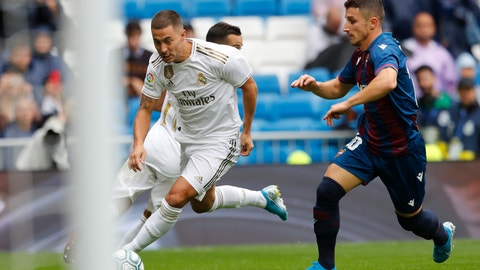 <p>               Real Madrid's Eden Hazard, left, vies for the ball with Levante's Enis Bardhi during the Spanish La Liga soccer match between Real Madrid and Levante at the Santiago Bernabeu stadium in Madrid, Spain, Saturday, Sept. 14, 2019. (AP Photo/Bernat Armangue)             </p>