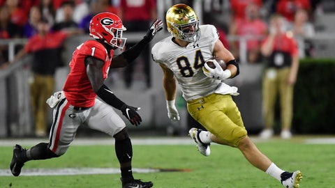 <p>               Notre Dame tight end Cole Kmet (84) runs against Georgia defensive back Divaad Wilson (1) during the first half of an NCAA college football game, Saturday, Sept. 21, 2019, in Athens, Ga. (AP Photo/Mike Stewart)             </p>