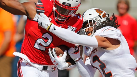 <p>               Utah running back Zack Moss (2) is tackled by Idaho State defensive back Adkin Aguirre (12) in the first half of an NCAA college football game Saturday, Sept. 14, 2019, in Salt Lake City. (AP Photo/Rick Bowmer)             </p>