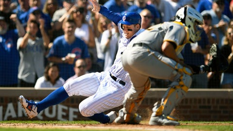 <p>               Chicago Cubs' Anthony Rizzo slides safely into home plate on a Nicholas Castellanos double as Pittsburgh Pirates catcher Elias Diaz waits for the throw during the second inning of a baseball game Saturday, Sept. 14, 2019, in Chicago. (AP Photo/Paul Beaty)             </p>