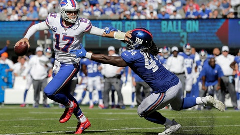 <p>               Buffalo Bills quarterback Josh Allen, left, evades New York Giants' Markus Golden during the second half of an NFL football game, Sunday, Sept. 15, 2019, in East Rutherford, N.J. (AP Photo/Adam Hunger)             </p>