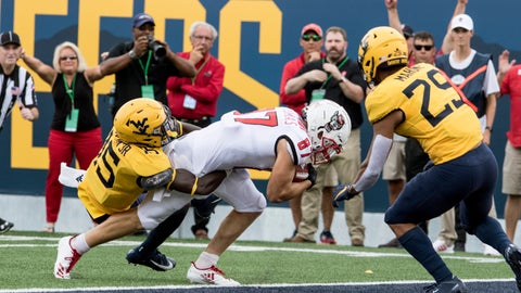 <p>               North Carolina State wide receiver Thayer Thomas (87) crosses the goalie for a touchdown as West Virginia safety Kerry Martin Jr. (15) attempts a tackle during the first half of an NCAA college football game Saturday, Sept. 14, 2019, in Morgantown, W.Va. (AP Photo/Raymond Thompson)             </p>