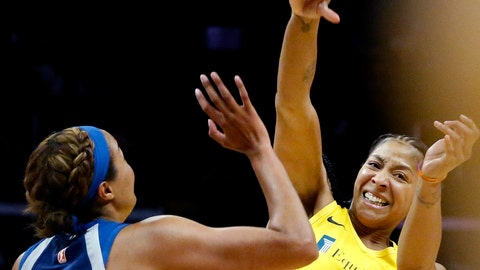 <p>               Los Angeles Sparks' Candace Parker, right, passes the ball while defended by Minnesota Lynx's Napheesa Collier during the second half of a WNBA basketball game in Los Angeles, Sunday, Sept. 8, 2019. (AP Photo/Ringo H.W. Chiu)             </p>
