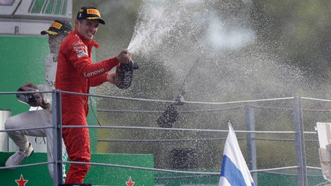 <p>               Ferrari driver Charles Leclerc of Monaco sprays champagne as celebrates on podium after winning the Formula One Italy Grand Prix at the Monza racetrack, in Monza, Italy, Sunday, Sept. 8, 2019. (AP Photo/Luca Bruno)             </p>
