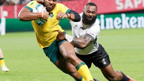 <p>               Australia's Samu Kerevi, left, prepares to score a try while being tackled by Fiji's Semi Radradra during the Rugby World Cup Pool D game at Sapporo Dome between Australia and Fiji in Sapporo, northern Japan, Saturday, Sept. 21, 2019. (Masanori TakeiKyodo News via AP)             </p>