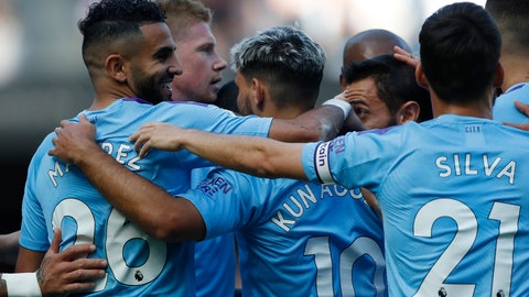 <p>               Manchester City's Riyad Mahrez, left, celebrates with teammates after scoring his sides third goal during the English Premier League soccer match between Manchester City and Watford at Etihad stadium in Manchester, England, Saturday, Sept. 21, 2019. (AP Photo/Rui Vieira)             </p>