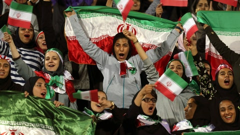 """<p>               FILE - In this Oct. 16, 2018 file photo, Iranian women cheer as they wave their country's flag after authorities in a rare move allowed a select group of women into Azadi stadium to watch a friendly soccer match between Iran and Bolivia, in Tehran, Iran. Sahar Khodayari, an Iranian female soccer fan died after setting herself on fire outside a court after learning she may have to serve a six-month sentence for trying to enter a soccer stadium where women are banned, a semi-official news agency reported Tuesday, Sept. 10, 2019. The 30-year-old was known as the """"Blue Girl"""" on social media for the colors of her favorite Iranian soccer team, Esteghlal. (AP Photo/Vahid Salemi, File)             </p>"""