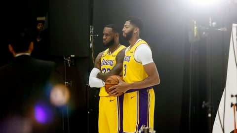 <p>               Los Angeles Lakers forwards LeBron James, center left, and Anthony Davis, center right, pose for photos during the NBA basketball team's media day in El Segundo, Calif., Friday, Sept. 27, 2019. (AP Photo/Ringo H.W. Chiu)             </p>