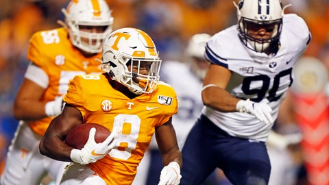 <p>               Tennessee running back Ty Chandler (8) outruns Brigham Young defensive lineman Devin Kaufusi (90) in the first half of an NCAA college football game Saturday, Sept. 7, 2019, in Knoxville, Tenn. (AP Photo/Wade Payne)             </p>