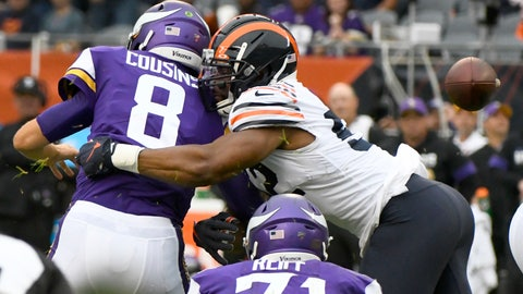<p>               Minnesota Vikings quarterback Kirk Cousins (8) fumbles the ball as he is sacked for a 7-yard loss by Chicago Bears outside linebacker Khalil Mack, right, during the second half of an NFL football game Sunday, Sept. 29, 2019, in Chicago. The Bears recovered the fumble. (AP Photo/Matt Marton)             </p>