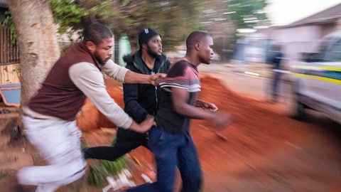 <p>               In this Monday, Sept. 2, 2019, photo, Nigerian foreign nationals remove a looter from their shops in Troyville, Johannesburg and take him to a waiting police van. Looting and violence spread across several neighbourhoods in South Africa's major cities of Pretoria and Johannesburg after a spate of attacks that appeared to target foreign-owned shops. (AP Photo)             </p>