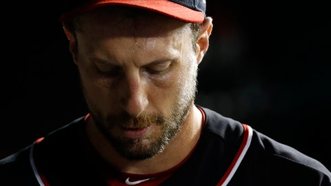 <p>               Washington Nationals starting pitcher Max Scherzer walks in the dugout in the bottom of the fifth inning of the team's baseball game against the Atlanta Braves, Friday, Sept. 13, 2019, in Washington. Atlanta scored a run against Scherzer in the fifth; he did not return for the sixth. (AP Photo/Patrick Semansky)             </p>