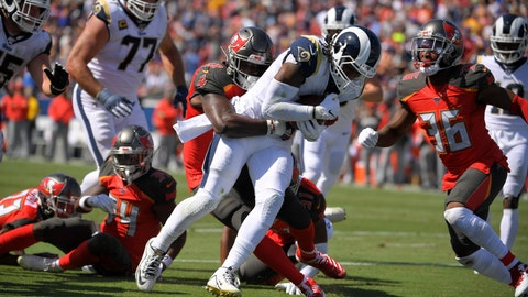 <p>               Los Angeles Rams running back Todd Gurley scores past Tampa Bay Buccaneers linebacker Shaquil Barrett during the first of an NFL football game Sunday, Sept. 29, 2019, in Los Angeles. (AP Photo/Mark J. Terrill)             </p>