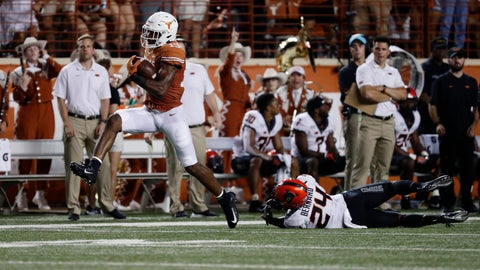 <p>               Texas wide receiver Brennan Eagles (13) high steps past Oklahoma State safety Jarrick Bernard (24) for a 73-yard touchdown during the first half of an NCAA college football game Saturday, Sept. 21, 2019, in Austin, Texas. (AP Photo/Eric Gay)             </p>
