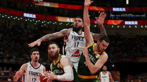<p>               Vincent Poirier of France battles the ball with Aron Baynes and Chris Goulding of Australia during their third placing match for the FIBA Basketball World Cup at the Cadillac Arena in Beijing, Saturday, Sept. 13, 2019. (AP Photo/Ng Han Guan)             </p>