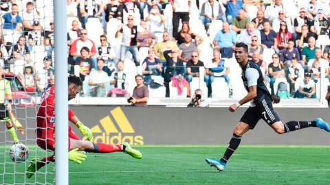 <p>               Juventus' Cristiano Ronaldo, right, scores during the Serie A soccer match between Juventus and Spal, at the Allianz Stadium in Turin, Italy, Saturday, Sept. 28, 2019. (Alessandro Di Marco/ANSA via AP)             </p>