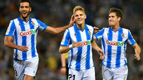 <p>               Real Sociedad's Martin Odegaard, center, celebrates with teammates Mikel Merino and Aritz Elustondo, right, after a goal of their team during the Spanish La Liga soccer match between Real Sociedad and Alaves at Reale Arena stadium, in San Sebastian, northern Spain, Thursday, Sept. 26, 2019. (AP Photo/Alvaro Barrientos)             </p>