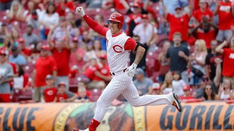<p>               Cincinnati Reds' Michael Lorenzen runs the bases after hitting a game-winning RBI double off Arizona Diamondbacks relief pitcher T.J. McFarland in the ninth inning of a baseball game, Sunday, Sept. 8, 2019, in Cincinnati. (AP Photo/John Minchillo)             </p>