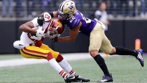 <p>               Southern Cal's Tyler Vaughns, left, is tackled by Washington's Trent McDuffie, right, in the first half of an NCAA college football game Saturday, Sept. 28, 2019, in Seattle. (AP Photo/Elaine Thompson)             </p>