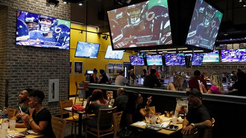 <p>               People eat and watch football at a Buffalo Wild Wings, Thursday, Sept. 5, 2019, in Las Vegas. MGM Resorts International and Buffalo Wild Wings are launching a mobile football game app for customers to pick favorite NFL teams, choose weekly fantasy performers and make proposition picks. Officials said the goal is to expand later at Buffalo Wild Wings in states where sports betting is legal through a mobile app called BetMGM. (AP Photo/John Locher)             </p>