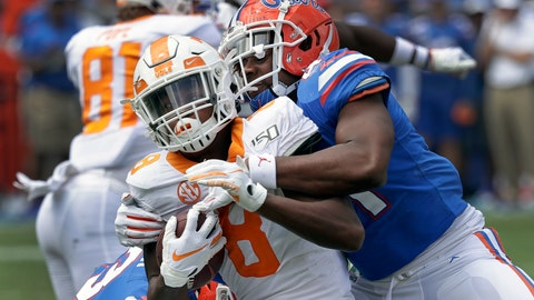<p>               Tennessee running back Ty Chandler, left, is stopped by Florida linebacker James Houston IV after a short gain during the second half of an NCAA college football game, Saturday, Sept. 21, 2019, in Gainesville, Fla. (AP Photo/John Raoux)             </p>