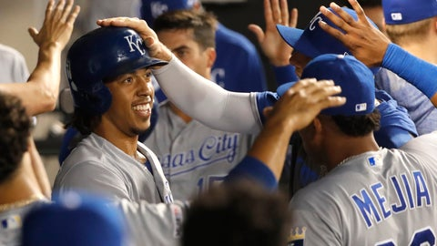 <p>               Kansas City Royals' Adalberto Mondesi, left, celebrates in the dugout after his two-run home run off Chicago White Sox starting pitcher Reynaldo Lopez, during the third inning of a baseball game Wednesday, Sept. 11, 2019, in Chicago. (AP Photo/Charles Rex Arbogast)             </p>