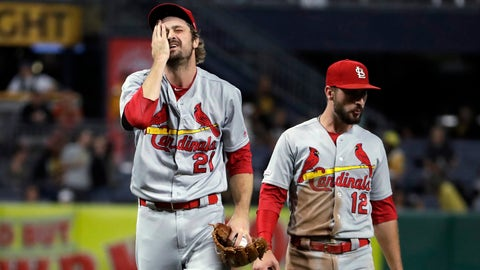 St. Louis Cardinals relief pitcher Andrew Miller (21) is joined by Paul DeJong as he waits to hand the ball to manager Mike Shildt after giving up an RBI single to Pittsburgh Pirates' Melky Cabrera during the seventh inning of a baseball game in Pittsburgh, Friday, Sept. 6, 2019. (AP Photo/Gene J. Puskar)