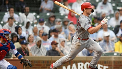 St. Louis Cardinals' Paul Goldschmidt, right, watches his RBI-double during the ninth inning of a baseball game against the Chicago Cubs, Sunday, Sept. 22, 2019, in Chicago. St. Louis won 3-2. (AP Photo/Paul Beaty)