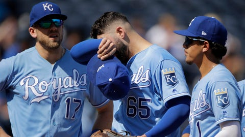 Kansas City Royals starting pitcher Jakob Junis (65) wipes his face before coming out of a baseball game during the third inning against the Houston Astros Sunday, Sept. 15, 2019, in Kansas City, Mo. (AP Photo/Charlie Riedel)