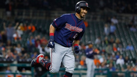 Minnesota Twins' Eddie Rosario smiles as he rounds the bases after hitting a two-run home run in the eighth inning of a baseball game against the Detroit Tigers in Detroit, Wednesday, Sept. 25, 2019. (AP Photo/Paul Sancya)