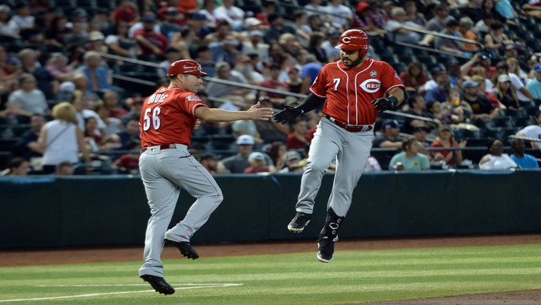 Suárez homers twice, Bauer fans 9 as Reds edge D-backs