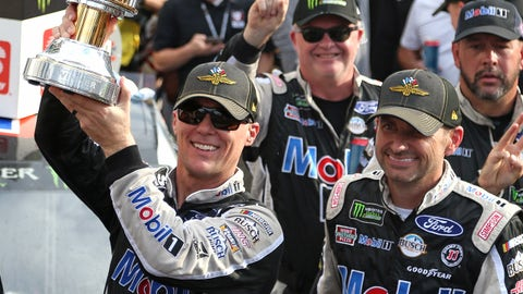 INDIANAPOLIS, INDIANA - SEPTEMBER 08: Kevin Harvick, driver of the #4 Mobil 1 Ford, celebrates in Victory Lane after winning the Monster Energy NASCAR Cup Series Big Machine Vodka 400 at the Brickyard at Indianapolis Motor Speedway on September 08, 2019 in Indianapolis, Indiana. (Photo by Matt Sullivan/Getty Images)