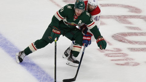 <p>               Minnesota Wild's Zach Parise controls the puck against Montreal Canadiens' Paul Byron in the first period of an NHL hockey game Sunday Oct. 20, 2019, in St. Paul, Minn. (AP Photo/Stacy Bengs)             </p>