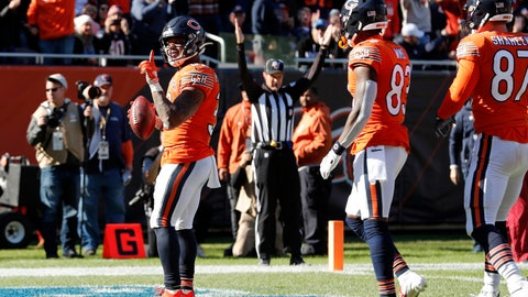 <p>               Chicago Bears running back David Montgomery, left, celebrates after scoring on a 4-yard touchdown run during the second half of an NFL football game against the Los Angeles Chargers, Sunday, Oct. 27, 2019, in Chicago. (AP Photo/Charles Rex Arbogast)             </p>