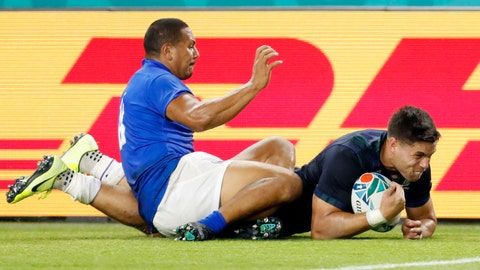 <p>               Samoa's Ed Fidow, left, slides in knees to stop Scotland's Sean Maitland scoring during the Rugby World Cup Pool A game at Kobe Misaki Stadium between Scotland and Samoa in Kobe, western Japan, Monday, Sept. 30, 2019. Fidow got a red card for giving away. (Ichiro Sakano/Kyodo News via AP)             </p>