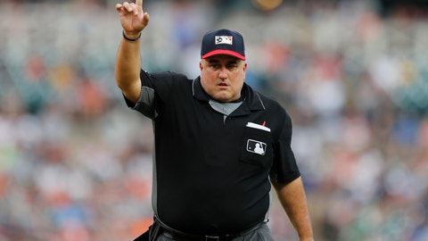 <p>               In this July 5, 2019, photo, home plate umpire Eric Cooper signals during the third inning of a baseball game between the Detroit Tigers and the Boston Red Sox in Detroit. Cooper, the Major League Baseball umpire who worked the AL Division Series two weeks ago, has died. He was 52. Commissioner Rob Manfred announced Cooper's death Sunday, Oct. 20. Cooper died after having a blood clot. (AP Photo/Carlos Osorio)             </p>
