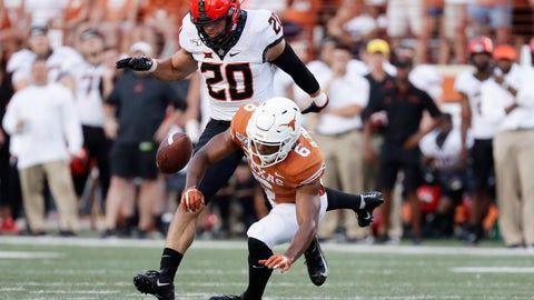 <p>               Oklahoma State safety Malcolm Rodriguez (20) breaks up a pass intended for Texas wide receiver Devin Duvernay (6) during the first half of an NCAA college football game Saturday, Sept. 21, 2019, in Austin, Texas. (AP Photo/Eric Gay)             </p>
