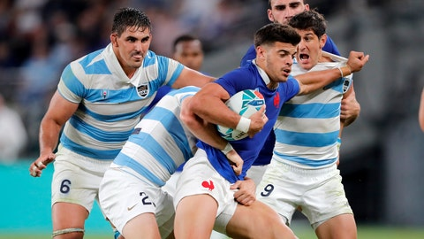 <p>               FILE - In this Saturday, Sept. 21, 2019 file photo, France's Romain Ntamack is tackled by Argentinian defenders during the Rugby World Cup Pool C game at Tokyo Stadium between France and Argentina in Tokyo, Japan. Flyhalf Ntamack, is the son of Emile Ntamack who played 46 times for France and is equal fifth on its all-time try scorers' list, is tipped to start Sunday's quarterfinal against Wales, 20 years after his father played the final. (AP Photo/Christophe Ena)             </p>