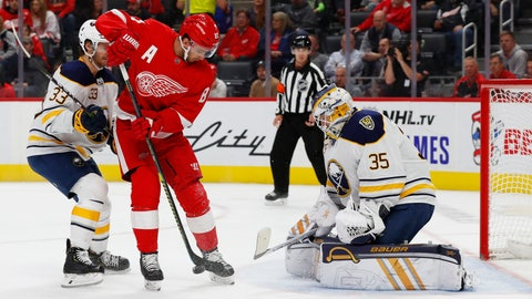 <p>               Buffalo Sabres goaltender Linus Ullmark (35) stops a shot by Detroit Red Wings center Frans Nielsen (81) in the second period of an NHL hockey game Friday, Oct. 25, 2019, in Detroit. (AP Photo/Paul Sancya)             </p>