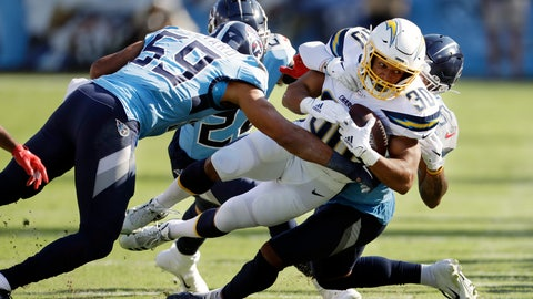 <p>               Los Angeles Chargers running back Austin Ekeler (30) is stopped by Tennessee Titans inside linebacker Wesley Woodyard (59) in the first half of an NFL football game Sunday, Oct. 20, 2019, in Nashville, Tenn. (AP Photo/James Kenney)             </p>