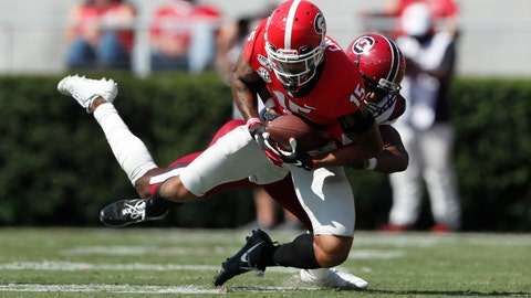 <p>               Georgia wide receiver Lawrence Cager (15) makes a catch as South Carolina defensive back Jaycee Horn (1) defends in the first half of an NCAA college football game Saturday, Oct. 12, 2019, in Athens, Ga. (AP Photo/John Bazemore)             </p>