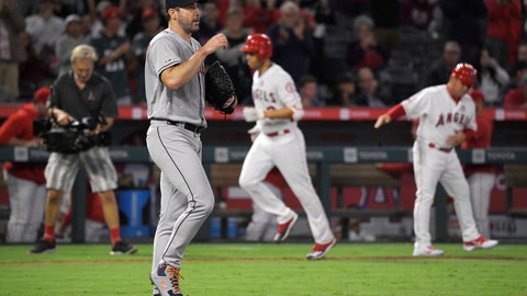 <p>               Houston Astros starting pitcher Justin Verlander, second from left, walks back to the mound after giving up a two-run home run to Los Angeles Angels' Andrelton Simmons, second from right, during the fourth inning of a baseball game Saturday, Sept. 28, 2019, in Anaheim, Calif. (AP Photo/Mark J. Terrill)             </p>