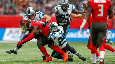 <p>               Tampa Bay Buccaneers running back Peyton Barber (25) is tackled by Carolina Panthers strong safety Eric Reid (25) and linebacker Devante Bond (59) during the first quarter of an NFL football game, Sunday, Oct. 13, 2019, at Tottenham Hotspur Stadium in London. (AP Photo/Alastair Grant)             </p>