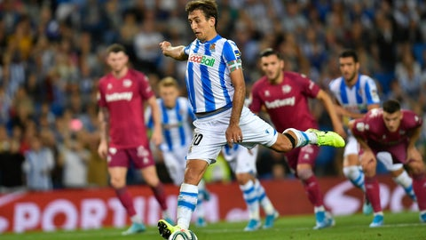 <p>               Real Sociedad's Mikel Oyarzabal, kicks the ball to score the third for his team during the Spanish La Liga soccer match between Real Sociedad and Alaves at Reale Arena stadium, in San Sebastian, northern Spain, Thursday, Sept. 26, 2019. (AP Photo/Alvaro Barrientos)             </p>