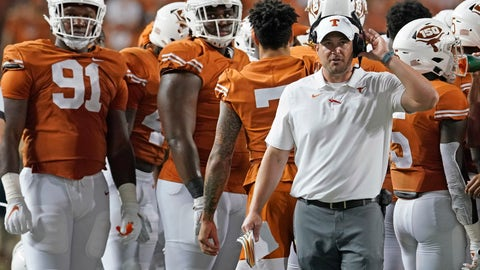 <p>               Texas coach Tom Herman, right, watches a replay during the second half of the team's NCAA college football game against Kansas in Austin, Texas, Saturday, Oct. 19, 2019. (AP Photo/Chuck Burton)             </p>