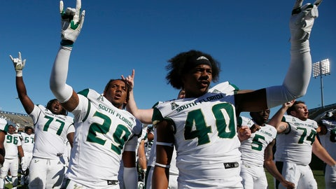 <p>               South Florida linebacker Brian Norris (29) and defensive end Jason Vaughn (40) celebrate with teammates after defeating Connecticut in an NCAA college football game in East Hartford, Conn., Saturday, Oct. 5, 2019. (AP Photo/Michael Dwyer)             </p>