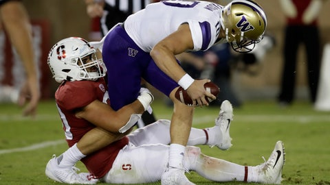 <p>               Washington quarterback Jacob Eason is sacked by Stanford's Scooter Harrington, left, in the second half of an NCAA college football game Saturday, Oct. 5, 2019, in Stanford, Calif. (AP Photo/Ben Margot)             </p>