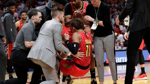 <p>               Atlanta Hawks guard Trae Young (11) is helped up off the court after an injury during the first half of the team's NBA basketball game against the Miami Heat, Tuesday, Oct. 29, 2019, in Miami. (AP Photo/Lynne Sladky)             </p>