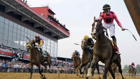 <p>               FILE - In this May 18, 2019, file photo, jockey Tyler Gaffalione, right, reacts aboard War of Will, as they crosses the finish line first to win the Preakness Stakes horse race at Pimlico Race Course in Baltimore. The owners of the historic racetrack that hosts the Preakness Stakes and Baltimore officials have reached an agreement to keep the Triple Crown series' middle jewel in the city. (AP Photo/Steve Helber, File)             </p>