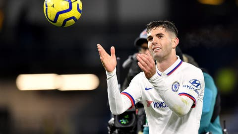 <p>               Chelsea's Christian Pulisic with the match ball after the final whistle after scoring a hat-trick during the English Premier League soccer match against Burnley at Turf Moor, Burnley, England Saturday Oct. 26, 2019. (Anthony Devlin/PA via AP)             </p>